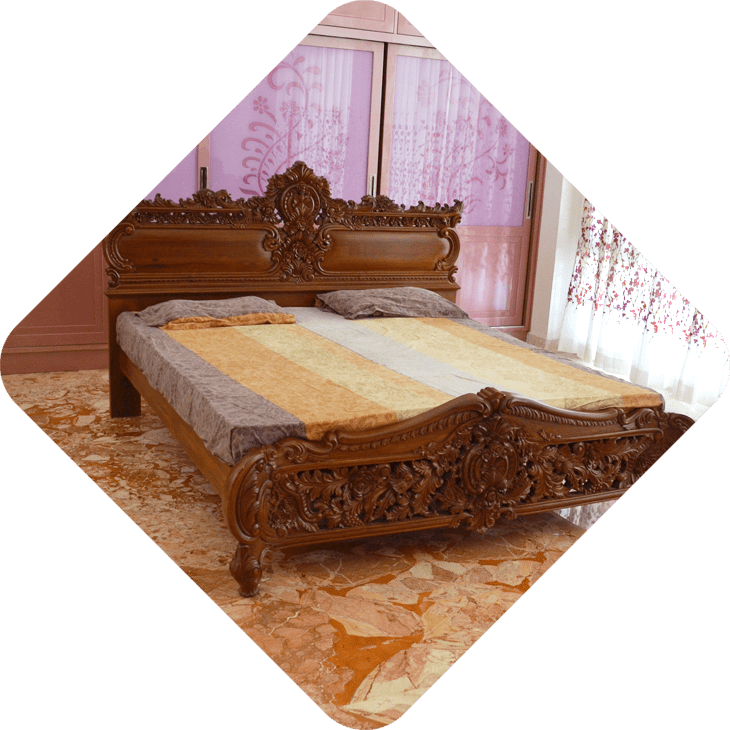 wooden carved cot